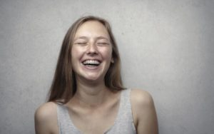 Woman Laughing 1080x675 1 The Benefits of Braces: Why You Should Get Them